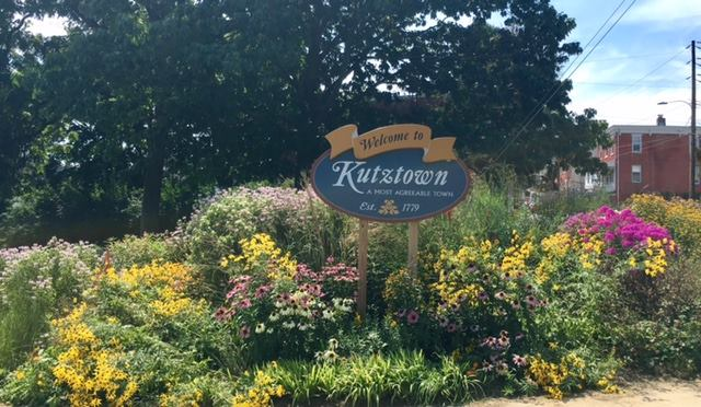 welcome to kutztown sign and flowerbed